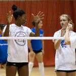 NMSU Aggie and camp counselor Whitney Woods explains the fine art of net play