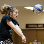 A Cloudcroft player digs the ball
