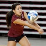 Freshman Shelby Tamura passes the ball