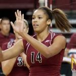 Freshman Desiree Scott gets a high five after a kill