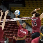 Sr. Whitney Woods smacks the ball for a point
