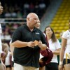 NMSU head coach Mike Jordan prepares to talk to his team before the second set