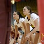 Jennah DeVries (left) and Kelsey Brennan prepare for the serve