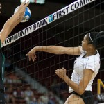 Des Scott tries to power the ball throught the Wahine defense